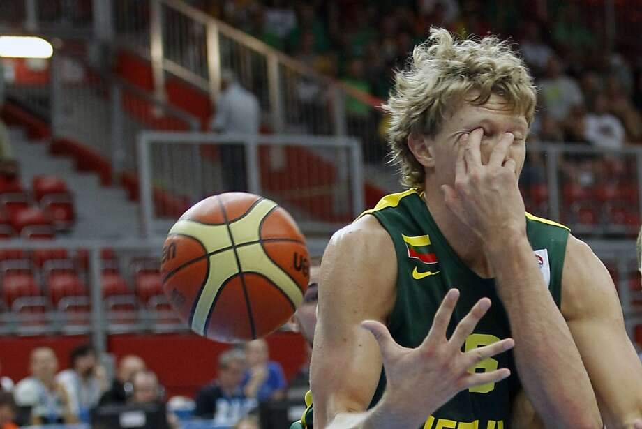 Shorter than your opponent? You could always try the eye gouge: Lithuania's Mindaugas gets poked by Latvia's Kaspars Berzins while scuffling for a rebound during a EuroBasket Championship Group B match in Jesenice, 