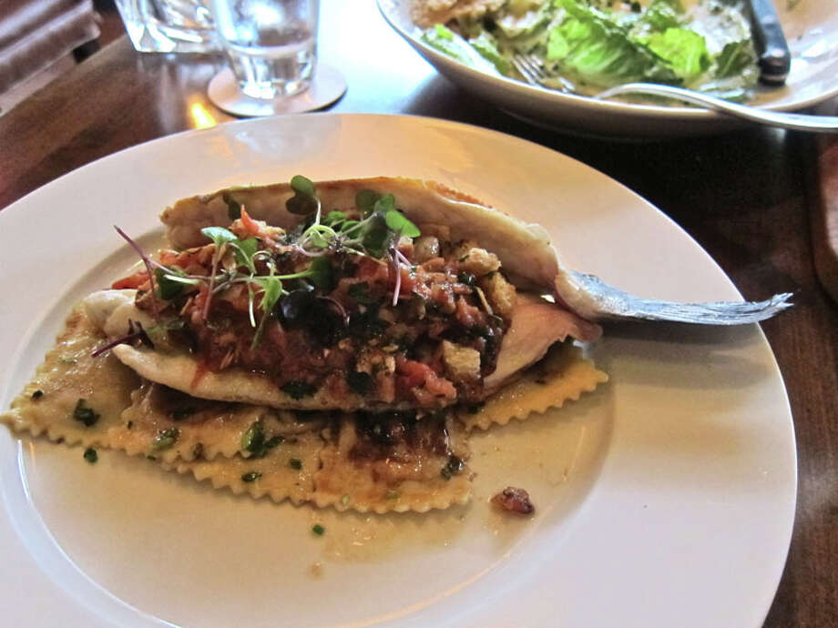 Hard-seared branzino with tomato, almond, lemon and brown butter at Hubbell & Hudson Bistro. Photo: Alison Cook, Houston Chronicle
