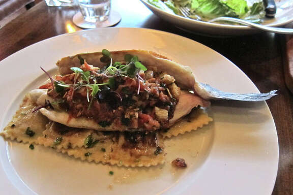 Hard-seared branzino with tomato, almond, lemon and brown butter at Hubbell & Hudson Bistro. .