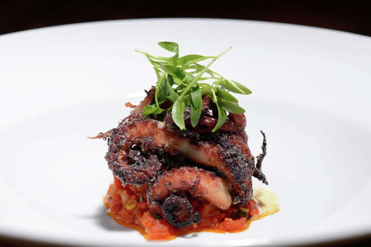 Red Wine Braised Octopus with sake tomato marmalata and kimchi foam are part a new seasonal menu by Chef Austin Simmons for Hubbell & Hudson Bistro.