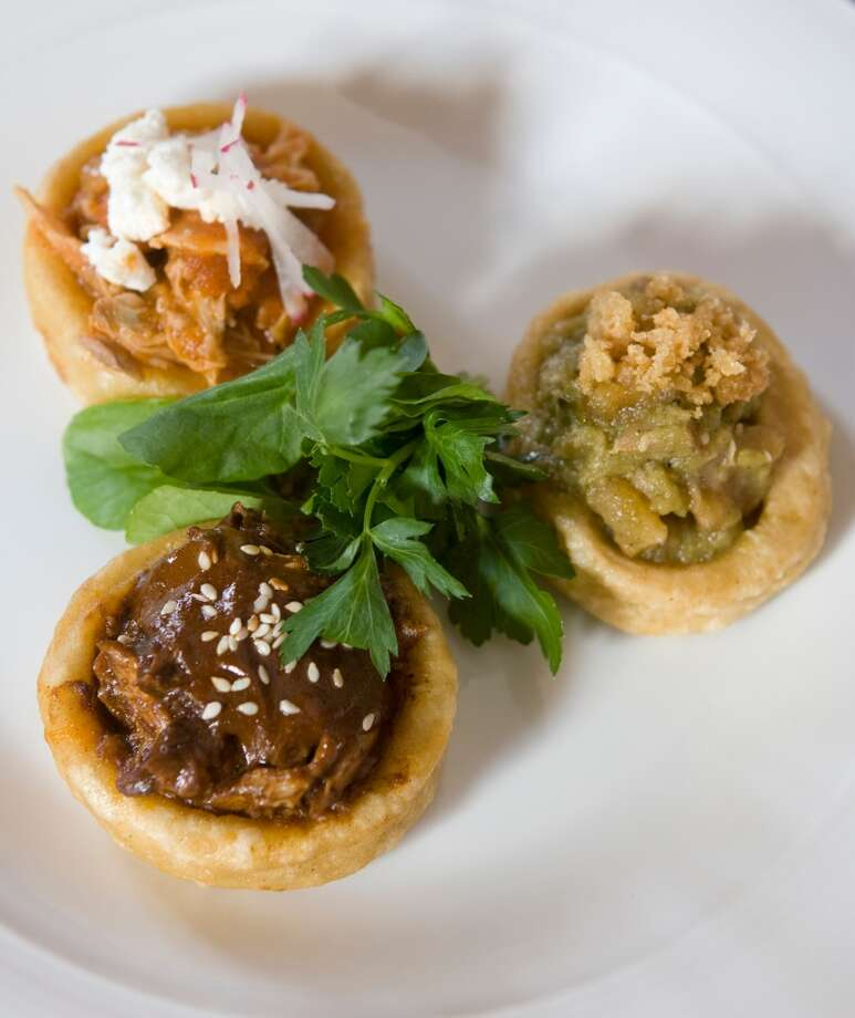 Duck mole sopesito, rabbit tinga and pork cracklings in salsa verde are a featured dish at Hugo's. Photo: Steve Campbell, Houston Chronicle