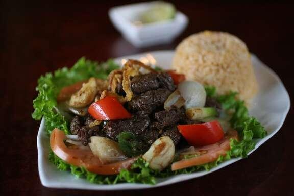 Marinated stir-fried beef, jalapenos  and garlic at Huynh