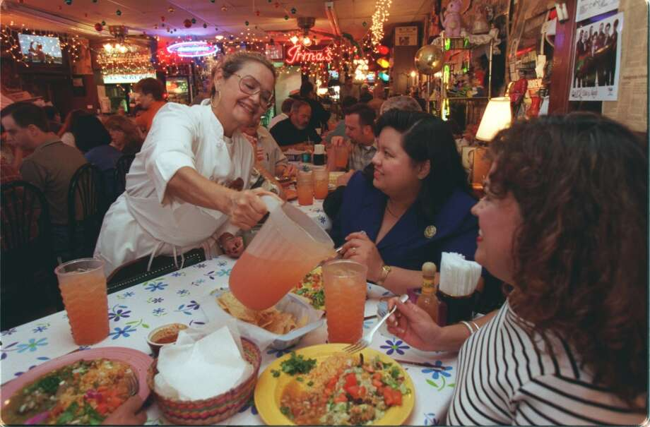 Irma Galvan pours lemonade for customers at Irma's. Photo: Betty Tichich, Houston Chronicle