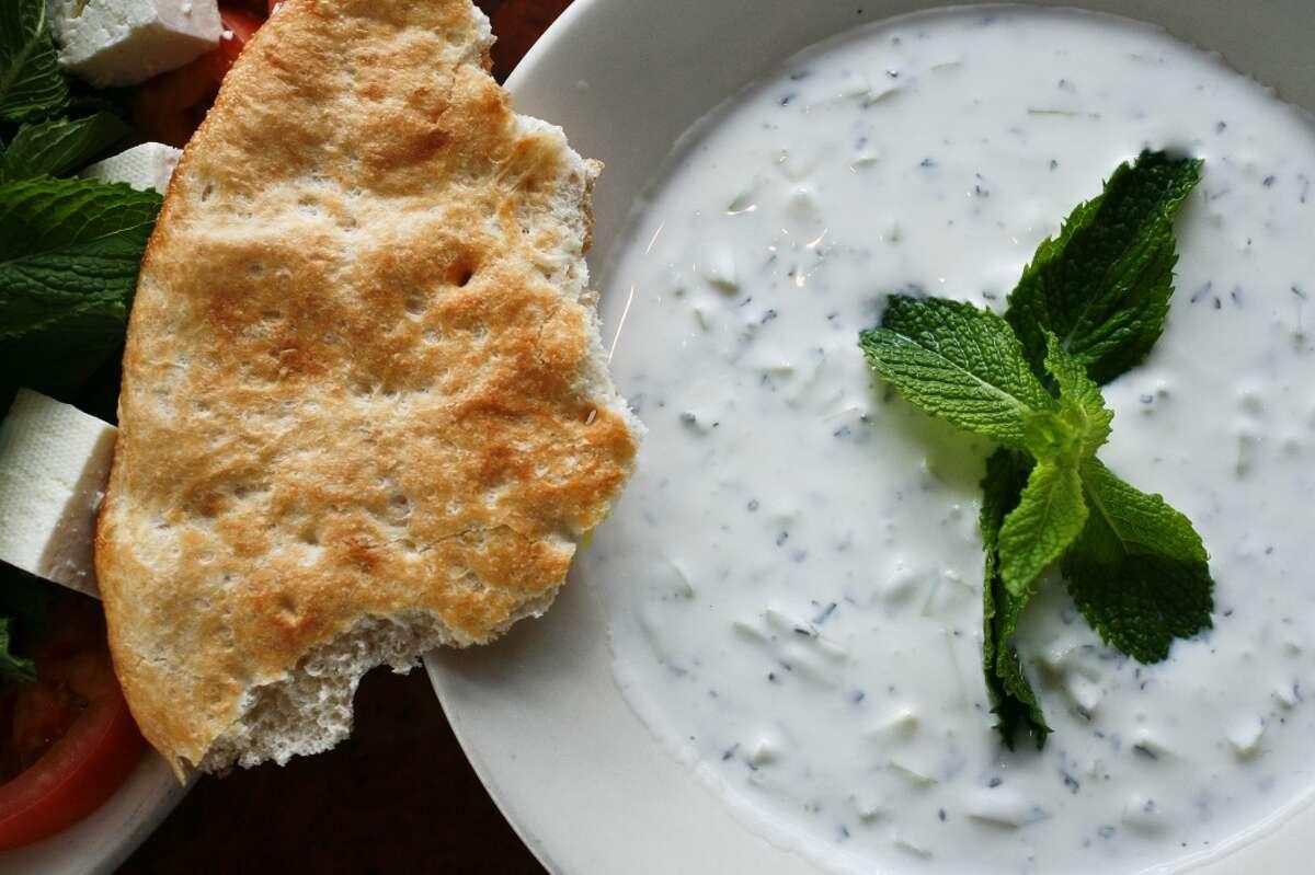 The Mast Khiar, a yogurt with cucumber appetizer, and Taftoon bread at Kasra