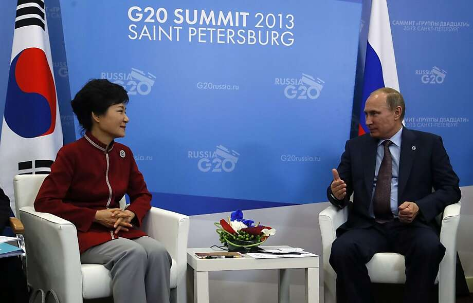OK if I take my shirt off now? Vladimir Putin speaks with South Korean President Park Geun-Hye at the G20 summit in St. Petersburg. Photo: Sergei Chirikov, AFP/Getty Images