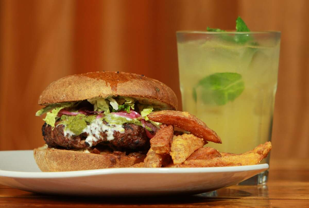A Desi burger and fries with a Panna beverage at Pondicheri.