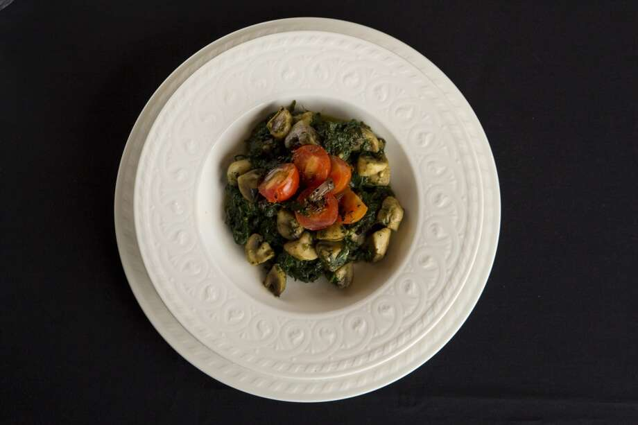 A bowl of spinach with mushrooms and tomatoes at Kiran's Photo: Brett Coomer, Houston Chronicle