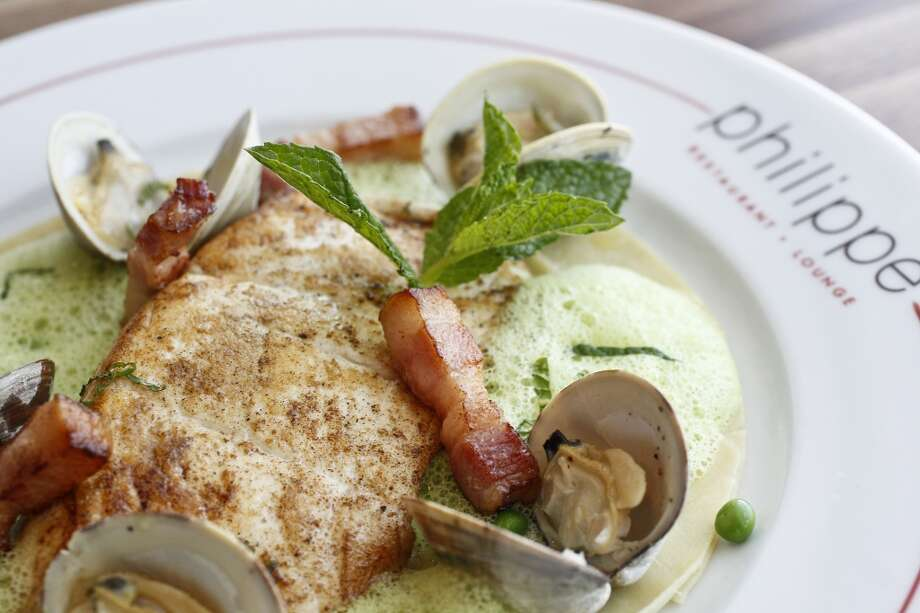 Pan-seared Halibat on a bed of Lasagna with Sweet Pea and Mint Emulsion, Clams and Lardon at Philippe Restaurant and Lounge. Photo: Michael Paulsen, Houston Chronicle