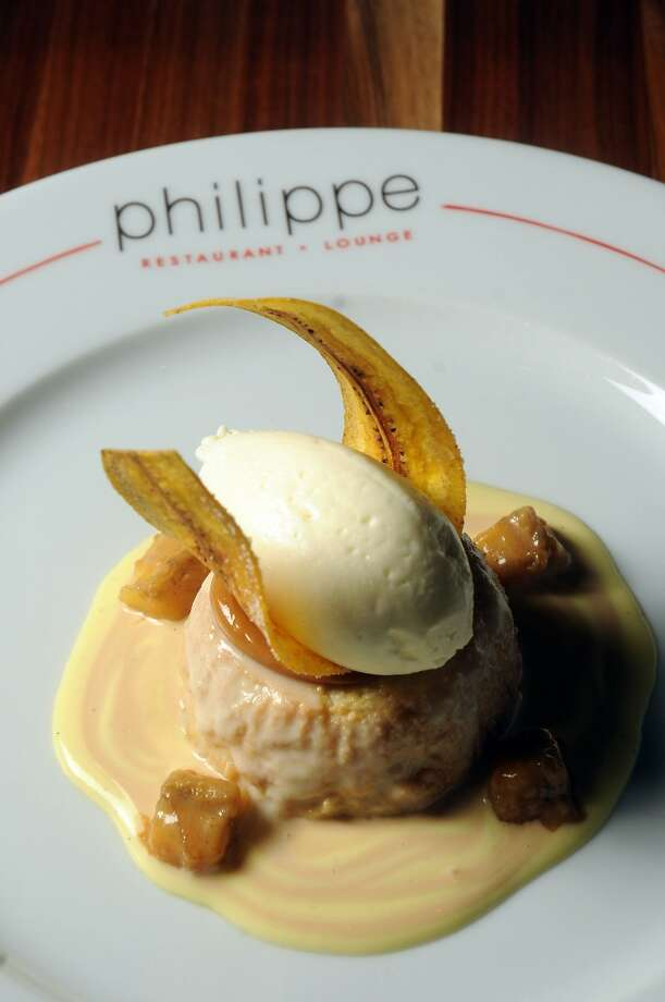 The tres leches with vanilla Chantilly, carmelized bananas and sour cream cajeta sauce at Philippe Restaurant. Photo: Dave Rossman, For The Chronicle