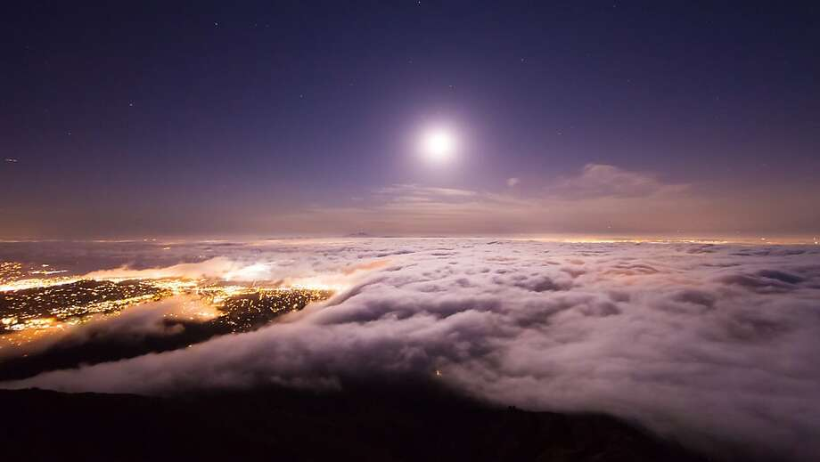 A full moon rises over a fog- shrouded San Francisco Bay. The next few nights will provide an excellent opportunity for beautiful nighttime hikes by moonlight. Photo: Simon Christen, Simon Christen Photography