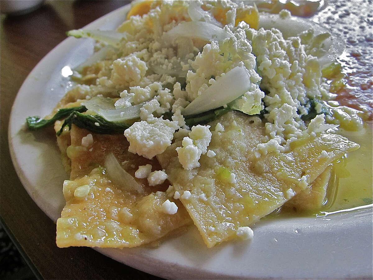 Chilaquiles verdes with queso fresco and epazote at La Guadalupana