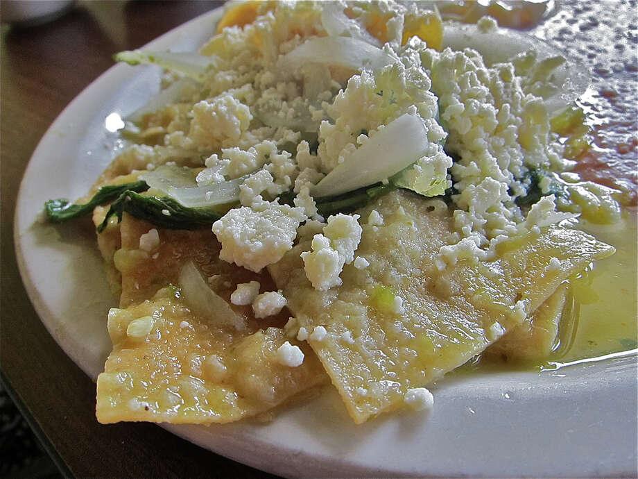 Chilaquiles verdes with queso fresco and epazote at La Guadalupana Photo: Alison Cook
