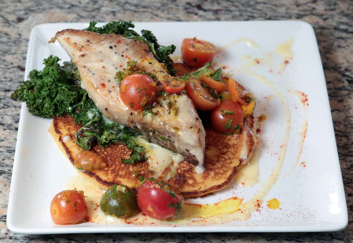 The Roasted Cobia : serrano Johnny cakes, garden greens, chow chow and lemon honey cream at Lucille's