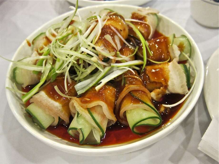 Garlic bacon appetizer, rolled with cucumber in red oil at Mala Sichuan Photo: Alison Cook