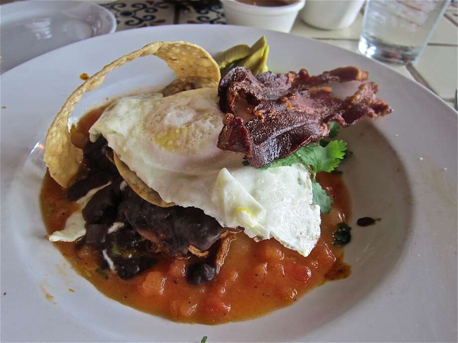 The wild version of huevos rancheros from the brunch menu of Ninfa's on Navigation. Photo: Alison Cook, Houston Chronicle