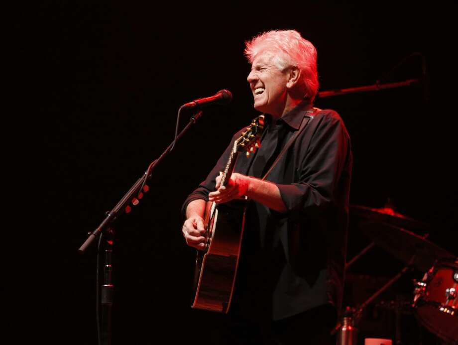 Graham Nash will be at the Ridgefield (Conn.) Playhouse on Wednesday, Sept. 11,, 2013. Here, he performs a a concert at the Nokia Theatre on Wednesday, Oct. 3, 2012, in Los Angeles. (Photo by Todd Williamson/Invision/AP) Photo: Todd Williamson, Associated Press