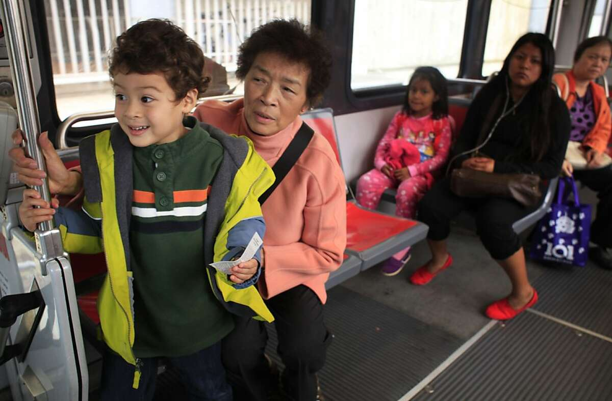 Ben Easter, 4, and his grandmother Maria Kwan huddle together at the front of the K train near their home San Francisco, Calif.