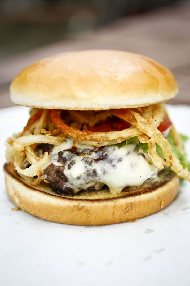 "The ""Cooter Jack"" at The Shack, with Jack cheese, chipotle mayo, fried onion strings and barbecue sauce. Photo: Michael Paulsen, Chronicle"