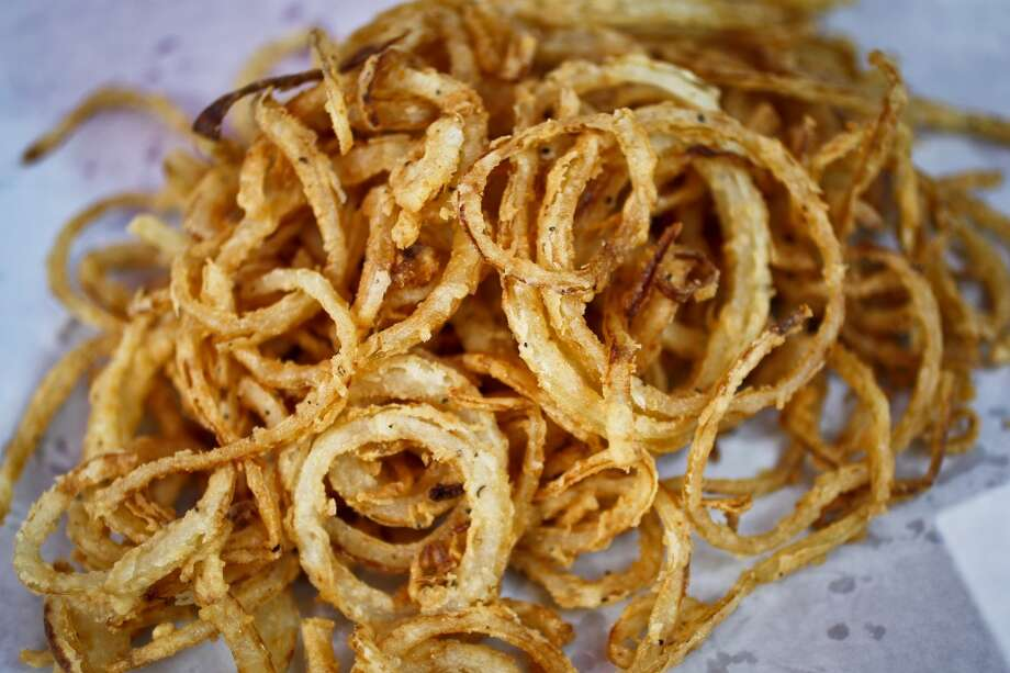 "A plate full of The Shack's ""Signature O-Strings"": 1015 Onion strings with buttermilk batter. Photo: Michael Paulsen, Chronicle"