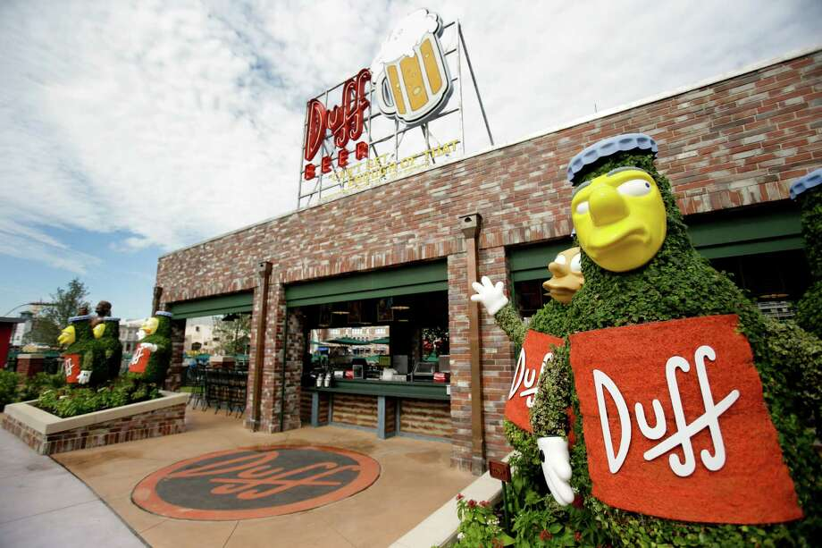 "This photo shows the entrance to Duff Gardens, serving Duff beer, at ""The Simpson's"" themed Springfield USA at Universal Orlando in Orlando, Fla. Built around ""he Simpsons"" ride that opened in 2008, the new zone is heavy on the tasty-yet-unhealthy food featured on the show. (AP Photo/John Raoux) Photo: Associated Press"