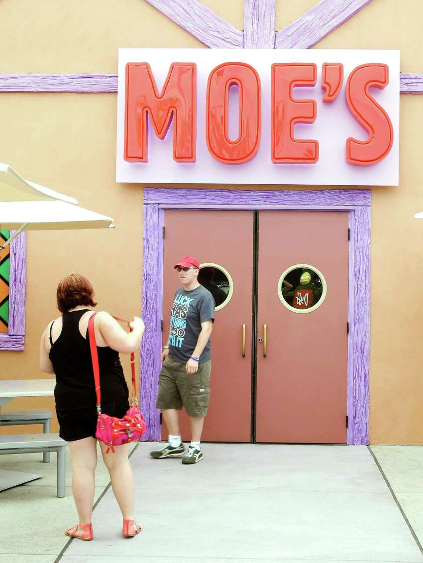 Guests snap photos at the entrance to Moe's Tavern in