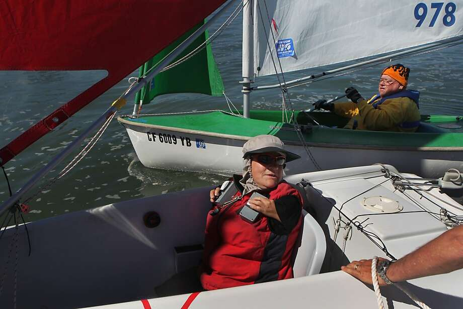 Helena Horswell of New Zealand (left) and Robert Betancourt Jr. of the United States get a tow from a motorboat because of low winds. Horswell is the world champion in the Access Liberty division. Photo: Leah Millis, The Chronicle