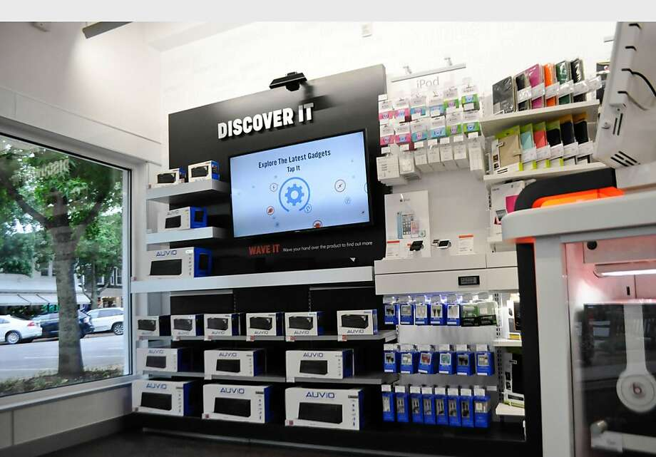 A station to test speakers is among the features in a redesigned RadioShack store in Southampton, N.Y. The company plans to introduce the remodeled stores in upscale, high-traffic locations. Photo: Associated Press