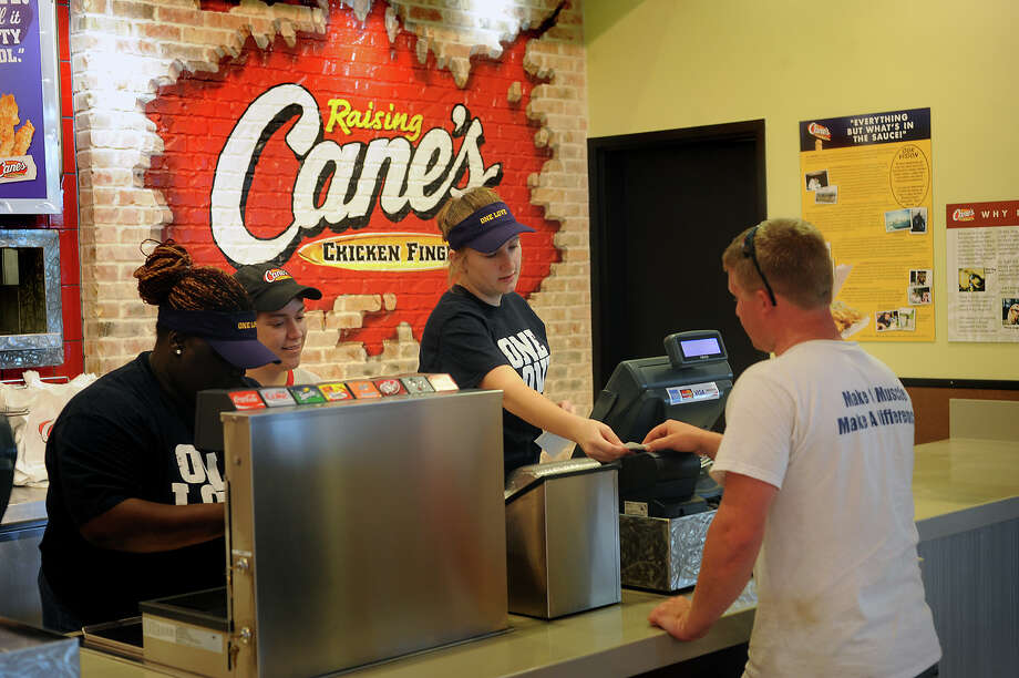 Blake Freeman orders from Leanna Boykin at Raising Cane's in the food court at Parkdale Mall on Tuesday, May 8, 2012. Guiseppe Barranco/The Enterprise Photo: Guiseppe Barranco, STAFF PHOTOGRAPHER / The Beaumont Enterprise