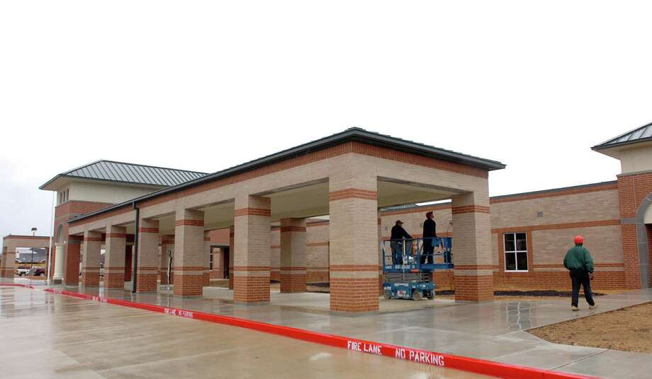 Finishing touches were being added to the facade of BISD's new Regina-Howell Elementary School Wednesday as it is prepared for students arrival next Monday. Pete Churton/The Enterprise Photo: Pete Churton / Beaumont