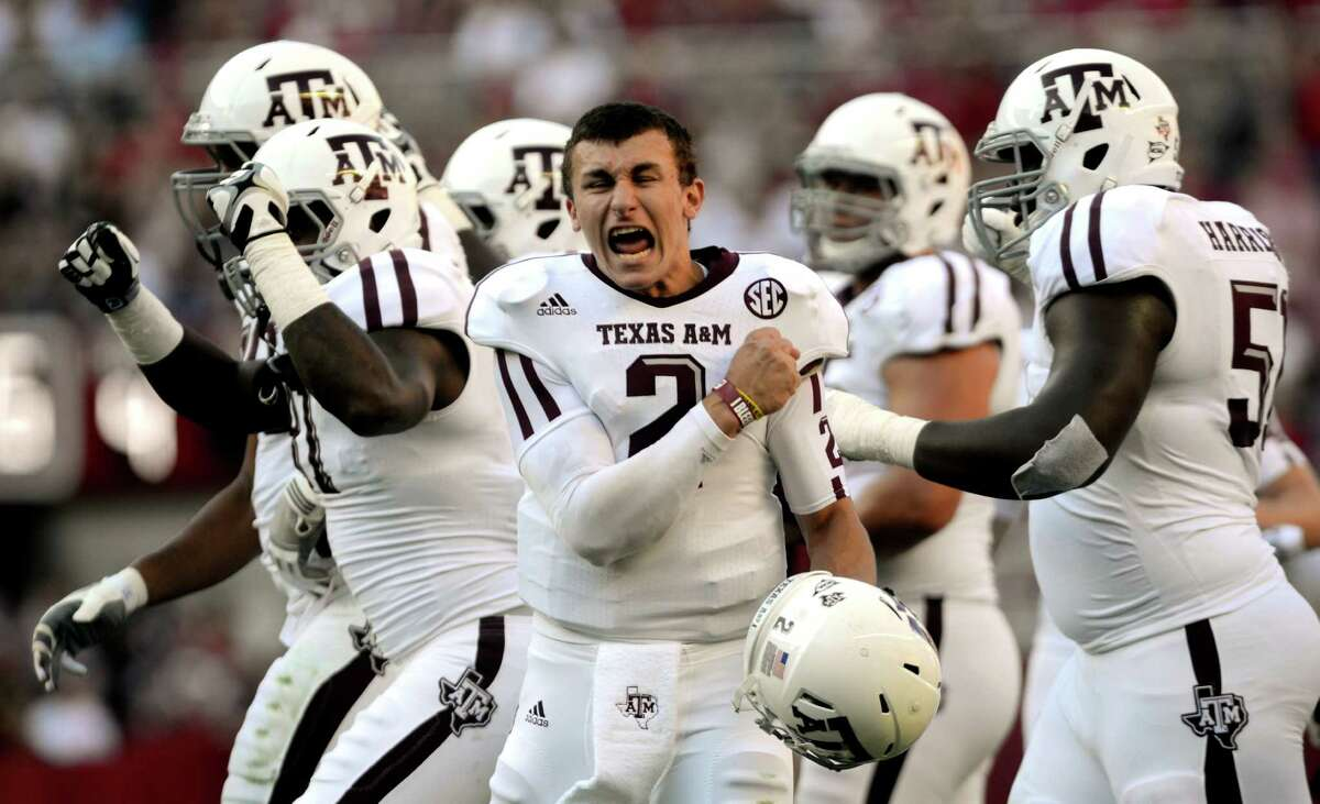 FILE - In this Nov. 10, 2012 file photo, Texas A&M quarterback Johnny Manziel (2) celebrates after a review proves an Aggie touchdown during the first half of their first SEC meeting against and Alabama in an NCAA college football game in Tuscaloosa, Ala. No. 1 Alabama has an extra week to absorb the hype and prep for a long-awaited grudge match with Texas A&M, the only team to beat the Crimson Tide last season. (AP Photo/The Decatur Daily, Gary Cosby Jr.)