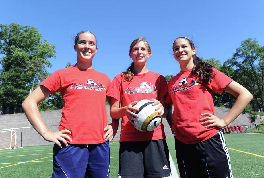 Greenwich High School girls varsity soccer captains from left, Caroline Markowitz, Liz Warner and Sarah Rodriguez during practice at the school in Greenwich, Friday, Sept. 6, 2013. Photo: Bob Luckey / Greenwich Time