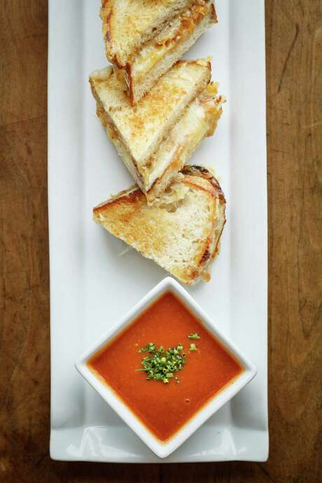 Mini grilled cheese bites are featured on Up's new bar menu. Photo: Michael Paulsen, Staff / © 2013 Houston Chronicle
