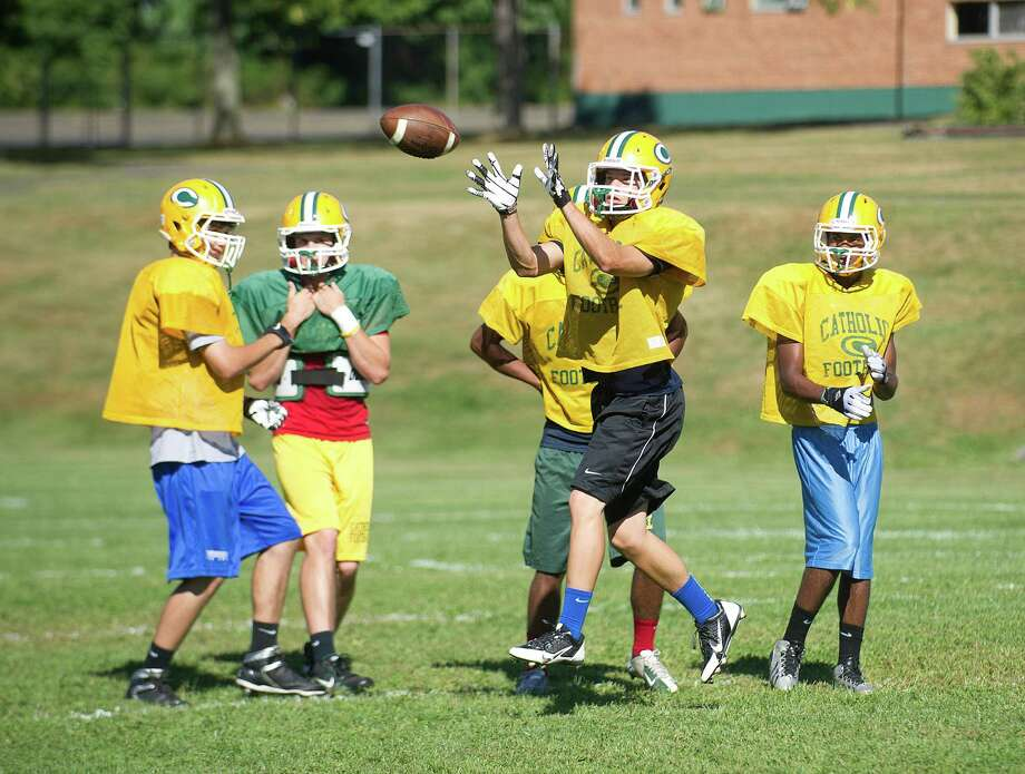 Sam Ruzzi makes a catch during Friday's practice at Trinity Catholic High School on Sept. 6, 2013. Photo: Lindsay Perry / Stamford Advocate