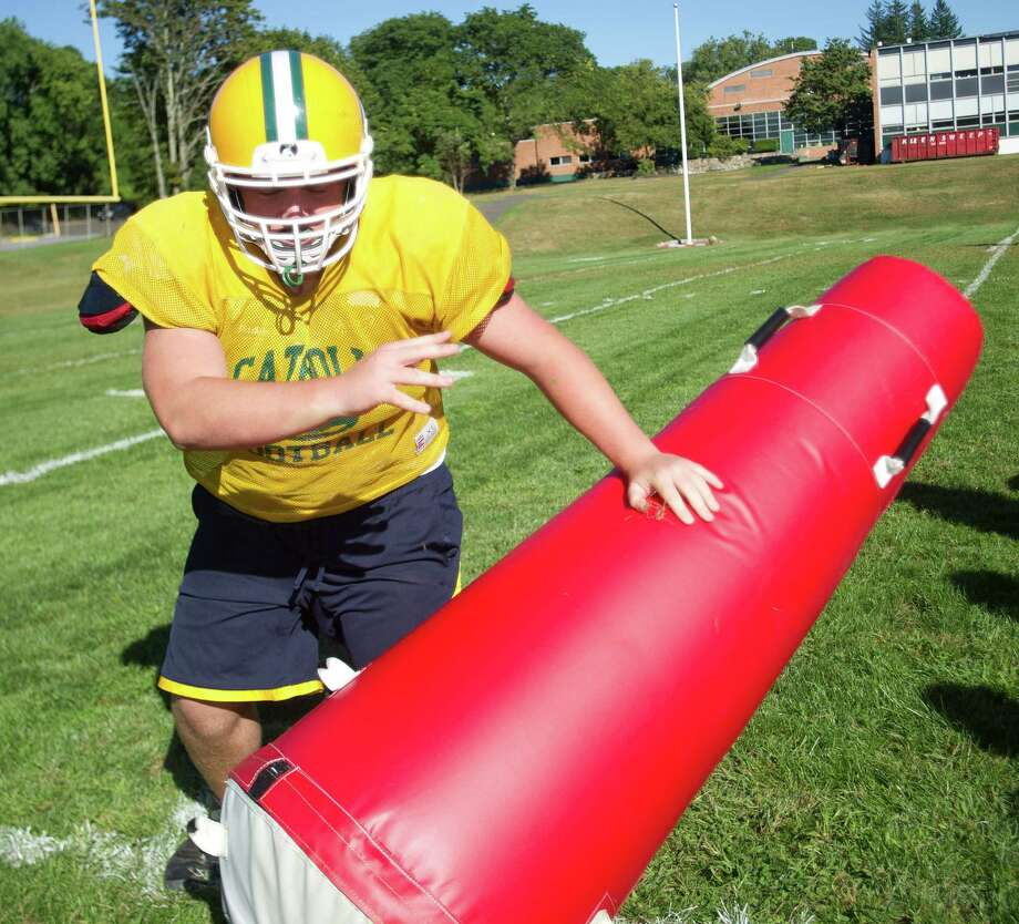 Tom Sweeney works during Friday's practice at Trinity Catholic High School on Sept. 6, 2013. Photo: Lindsay Perry / Stamford Advocate