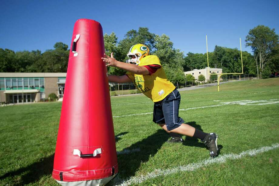 Mike Molgano works during Friday's practice at Trinity Catholic High School on Sept. 6, 2013. Photo: Lindsay Perry / Stamford Advocate