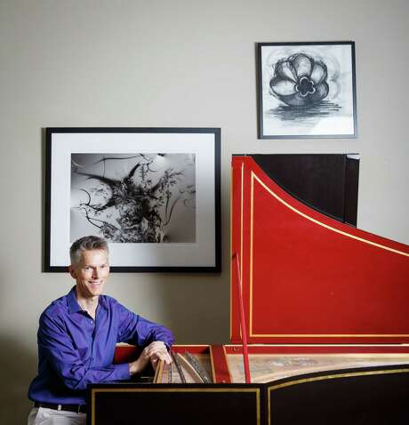 Matthew Dirst poses for a photo with his harpsichord at his home, Wednesday, Aug. 21, 2013, in Houston.  Dirst is an organist, harpsichordist, University of Houston music professor and founder of the Ars Lyrica early music group.  ( Michael Paulsen / Houston Chronicle ) Photo: Michael Paulsen, Staff / © 2013 Houston Chronicle