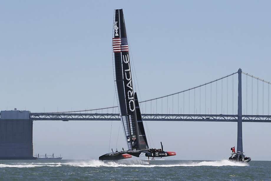 The Oracle Team USA trains aboard its AC72 on Thursday. Skipper Jimmy Spithill says the teams sail faster every day. Photo: Eric Risberg, Associated Press