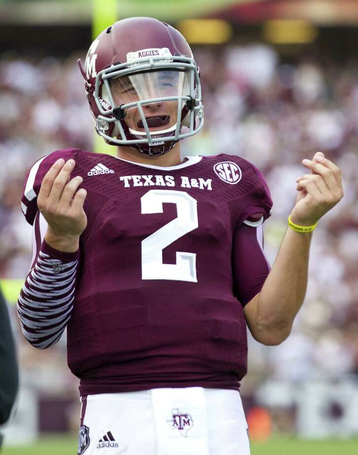 With Texas A&M quarterback Johnny Manziel, shown here gesturing after throwing a touchdown pass in the season opener against Rice, dominating the sports section and, sometimes, the news section, a weary reader proposes a moratorium on Johnny Football coverage. Photo: Brett Coomer, Houston Chronicle