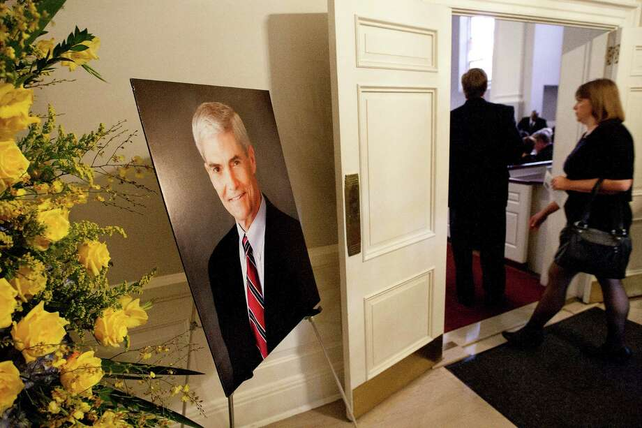 A photo of former District Attorney Mike Anderson sits in the foyer at First Presbyterian Church before his funeral on Friday. Anderson, 57, died on Saturday after a battle with cancer. Photo: Cody Duty, Houston Chronicle / © 2013 Houston Chronicle