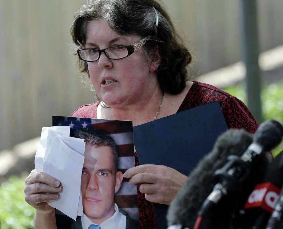 Gale Hunt holds a photo of her son, Spc. Jason Hunt, who was killed in the Fort Hood shootings. One reader says that Nidal Hasan, hoping to become a martyr, should not be executed. Photo: Eric Gay / Associated Press