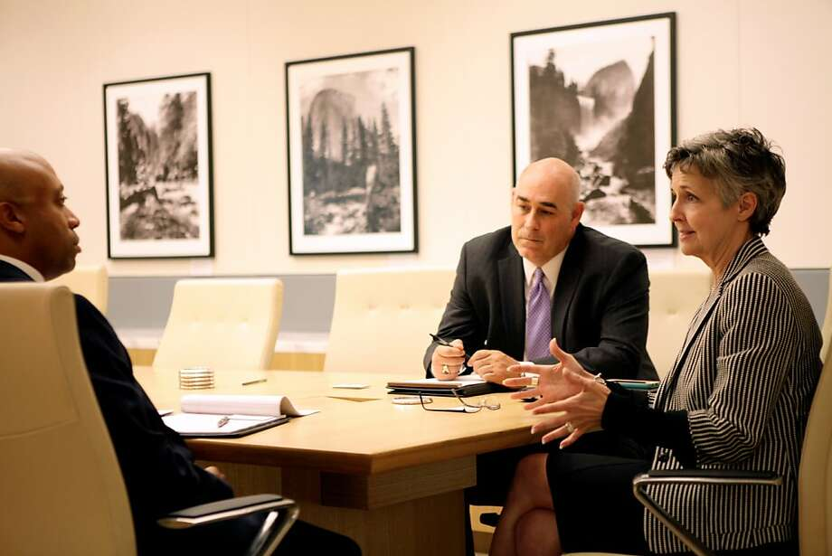 Jeffery Taylor of Wells Fargo Advisors (left) meets with Eric Williams and Mary Mewha of Wells Fargo's Abbot Downing group, a boutique bank that caters to clients with at least $50 million in liquid assets. Photo: Handout Photo, Abbot Downing
