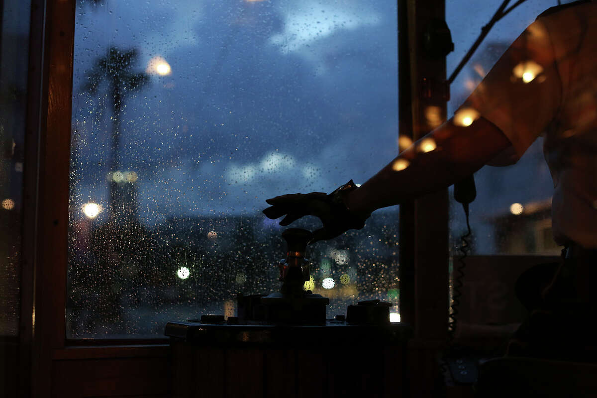 Motorman Connie Cosme drives the TECO Line Streetcar on a rainy evening in Tampa, FL on July 12, 2013.