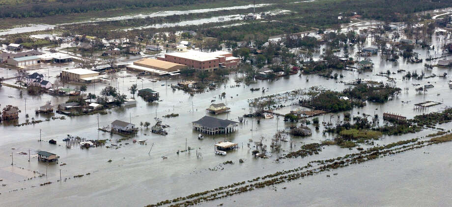 With Hurricane Ike's storm surge beginning to recede, cities such as Sabine Pass will have to deal with the saltwater intrusion in their drinking water and sewage treatment systems.  Dave Ryan/The Enterprise