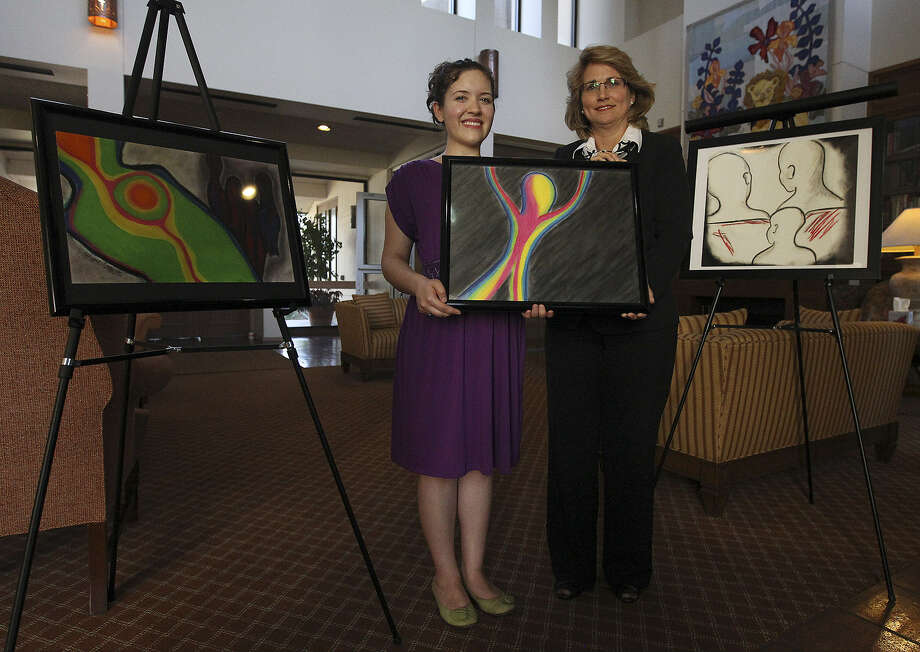 "Artist Abbigail Tamez (left) and Ecumenical Center for Religion and Health CEO Mary Beth Fisk present a sample of artwork on display in the exhibit ""Art Heals Hearts"" at the center. Photo: Kin Man Hui / San Antonio Express-News"