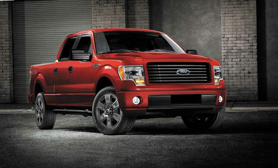 This undated photo provided by Ford shows the 2014 Ford F-150 STX SuperCrew truck.  Americans are paying record prices for new cars and trucks, and they have only themselves to blame. The average sale price of a vehicle in the U.S. hit $31,252 last month, up almost $1,000 over the same time last year, a sharp increase driven by consumers loading cars up with high-end stereos, navigation systems, leather seats and safety gadgets.   Many in the business think prices will moderate some because people who kept their cars through the recession and haven't replaced them yet won't load up on options.  Ford will try to please them this fall by adding a four-door cab to its F-150 STX line. Previously, the STX only came with a two-door cab. (AP Photo/Ford) ORG XMIT: NY120 / FORD