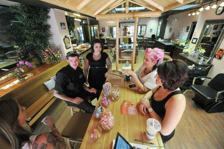 The staff of Patsy's Pin Ups Beauty Parlor talk around a Tiki bar at the new salon Friday afternoon, Sept. 6, 2013, on Howard Street in Albany, N.Y. (Michael P. Farrell/Times Union) Photo: Michael P. Farrell / 00023792A