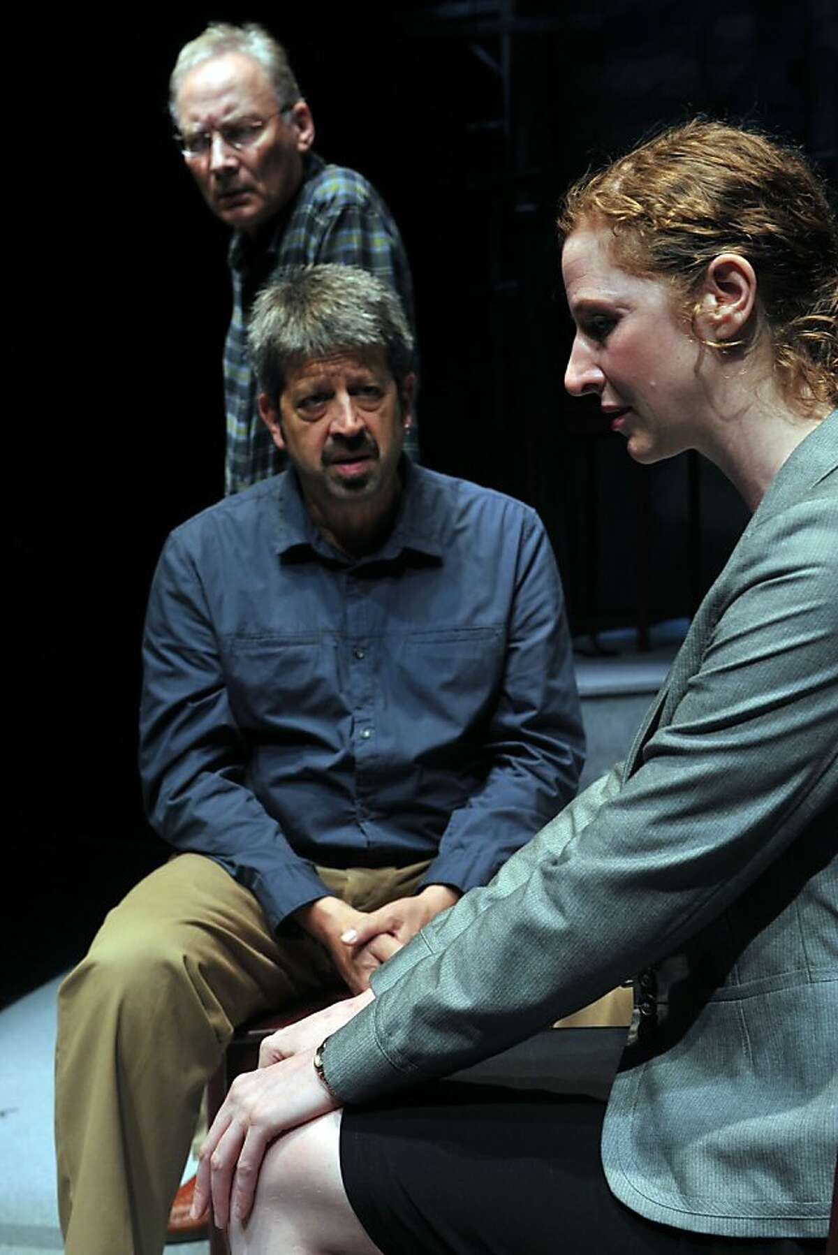 """Emma ( Jessica Bates, right) learns the truth about her revered grandfather from her father Ben (Rolf Saxon. left) and uncle Leo (Victor Talmadge) in """"After the Revolution"""" at Aurora Theatre"""