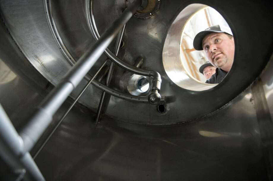 California: Jeremy Warren, brewmaster of Knee Deep Brewery, peers inside one of the tanks he will use to brew up his distinctive craft beers at the brewery's new 18,000-square-foot Auburn, California, site, scheduled to open later this month. Photo: Hector Amezcua, McClatchy-Tribune News Service