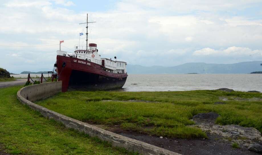 Canada: An old New York tugboat converted to a restaurant and social center on Ile-aux-Grues in the St. Lawrence Rive on the outskirts of Quebec City. The island offers quiet roads and stunning river vistas for cyclists and lovers of solitude. Photo: Calvin Woodward, Associated Press