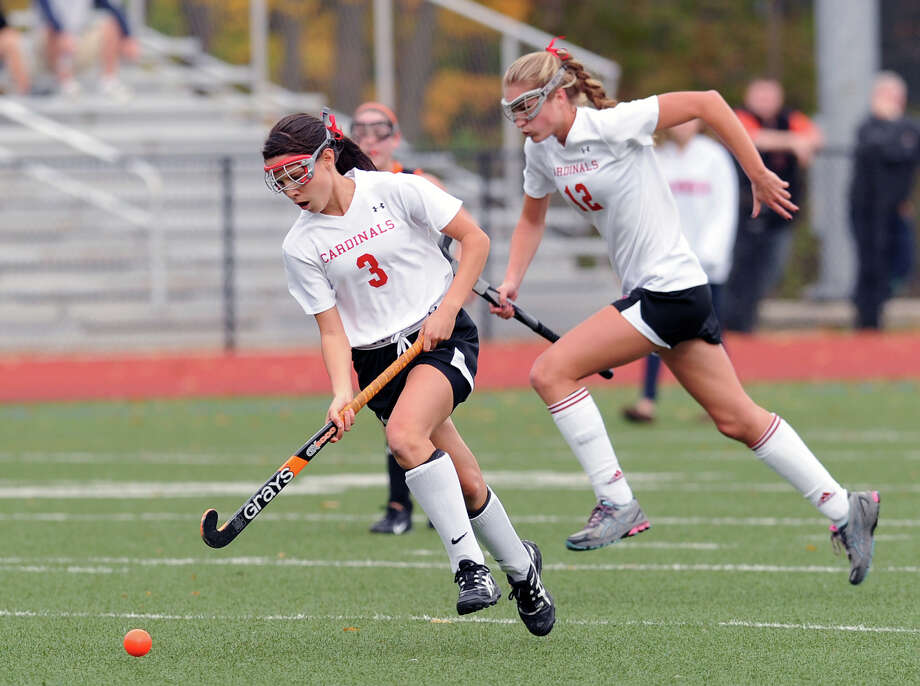 At left, Sydney Cole # 3 of Greenwich leads a charge follow by teammate Emily Brash during the FCIAC field hockey tournament match between Stamford High School and Greenwich High School at Greenwich, Saturday afternoon, Oct. 27, 2012. Photo: Bob Luckey / Greenwich Time